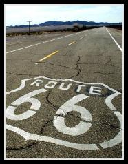 Route 66 is stenciled on the old road th